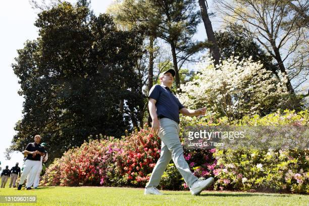 Patrick Reed of the United States and Robert MacIntyre of Scotland walk on the sixth hole during a practice round prior to the Masters at Augusta...