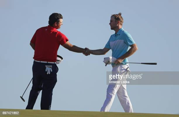 Patrick Reed of the United States and Russell Henley of the United States shake hands after finishing on the 18th green during the final round of the...