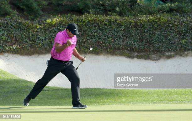 Patrick Reed of the United States celebrates a putt for birdie on the 12th hole during the final round of the 2018 Masters Tournament at Augusta...
