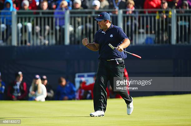 Patrick Reed of the United States celebrates a putt on the 13th green during the Morning Fourballs of the 2014 Ryder Cup on the PGA Centenary course...