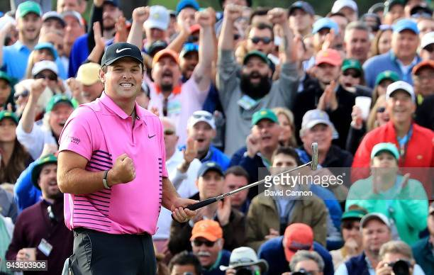 Patrick Reed of the United States celebrates after making par on the 18th green during the final round to win the 2018 Masters Tournament at Augusta...