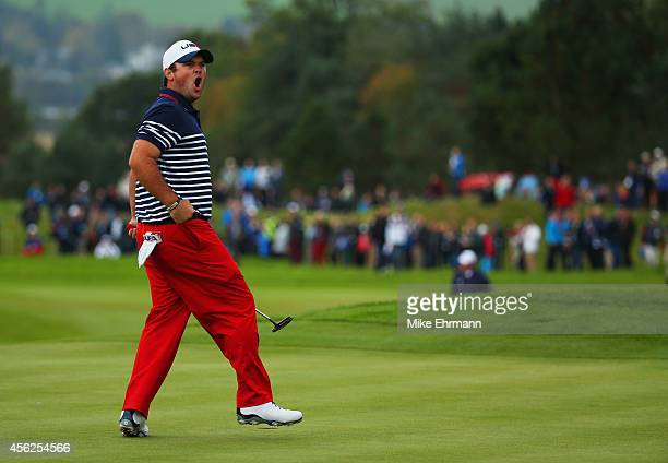 Patrick Reed of the United States celebrates his putt on the 11th green during the Singles Matches of the 2014 Ryder Cup on the PGA Centenary course...
