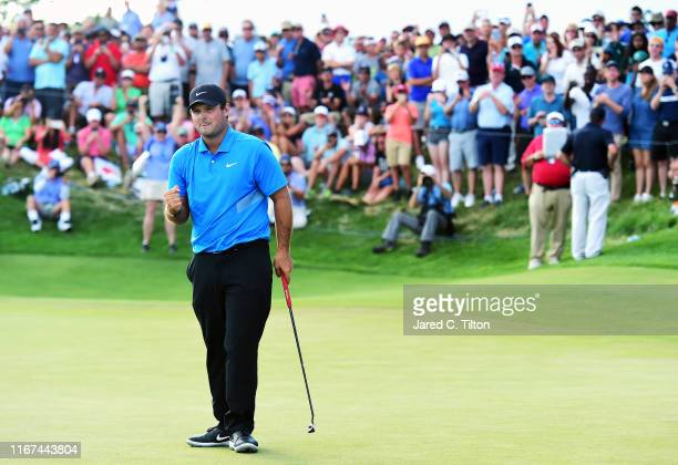 Patrick Reed of the United States celebrates on the 18th green after winning during the final round of The Northern Trust at Liberty National Golf...