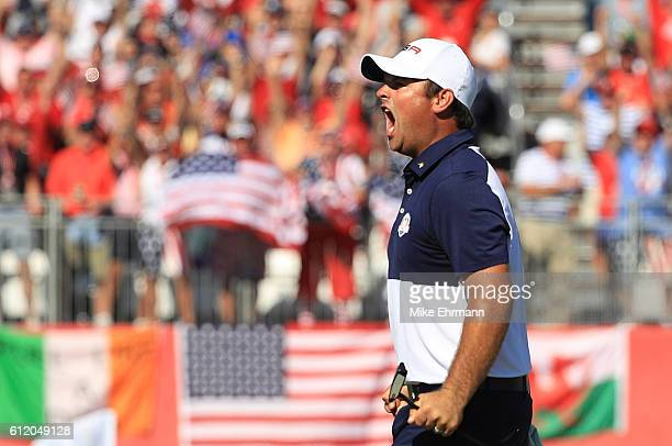 Patrick Reed of the United States celebrates on the 18th green after winning his match during singles matches of the 2016 Ryder Cup at Hazeltine...
