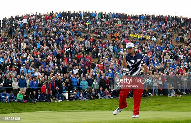 Patrick Reed of the United States celebrates on the 8th green during the Singles Matches of the 2014 Ryder Cup on the PGA Centenary course at the...