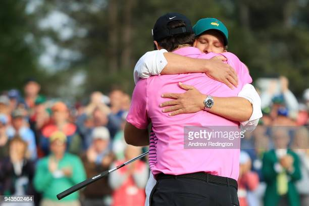 Patrick Reed of the United States celebrates with caddie Kessler Karain after making par on the 18th green during the final round to win the 2018...