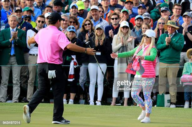 Patrick Reed of the United States celebrates with his wife Justine after making par 18th green during the final round to win the 2018 Masters...