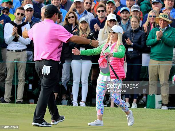 Patrick Reed of the United States celebrates with his wife Justine after making par on the 18th green during the final round to win the 2018 Masters...
