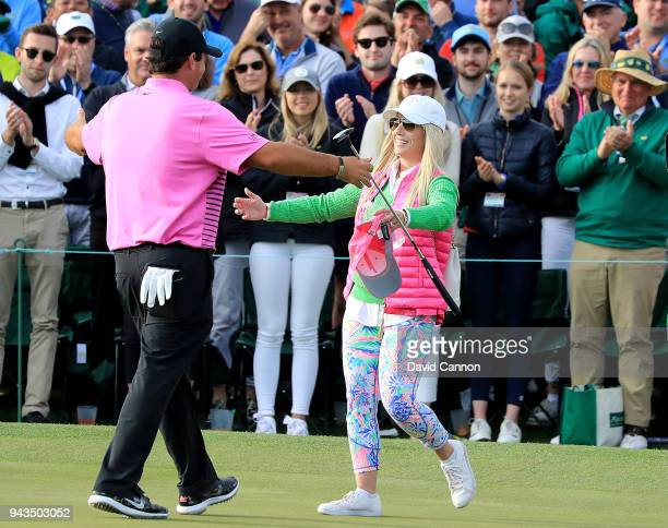 Patrick Reed of the United States celebrates with his wife Justine after making par on the18th green during the final round to win the 2018 Masters...
