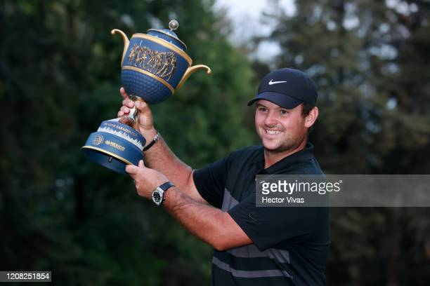 Patrick Reed of the United States celebrates with the Gene Sarazen Cup after winning in the final round of the World Golf Championships Mexico...