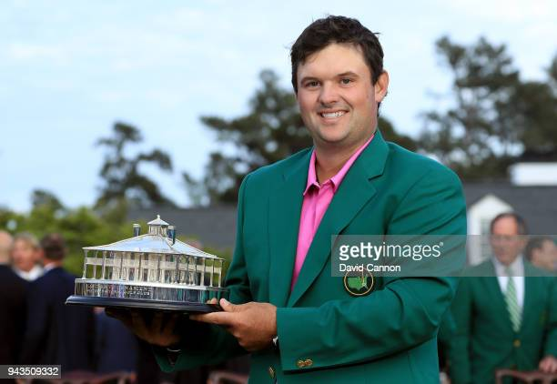 Patrick Reed of the United States celebrates with the trophy during the green jacket ceremony after winning the 2018 Masters Tournament at Augusta...