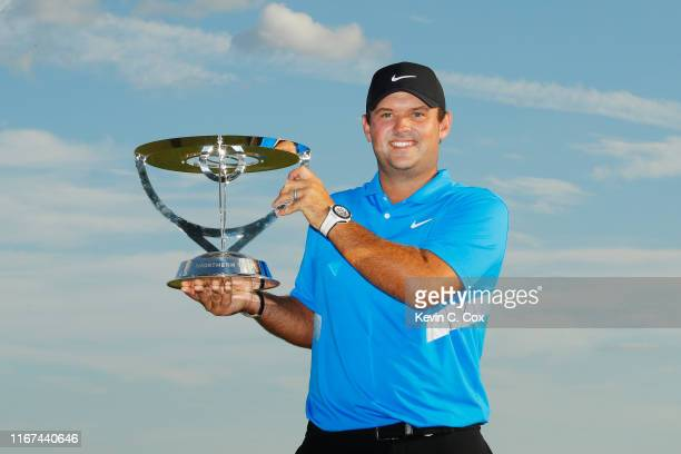 Patrick Reed of the United States celebrates with the winner's trophy after the final round of The Northern Trust at Liberty National Golf Club on...