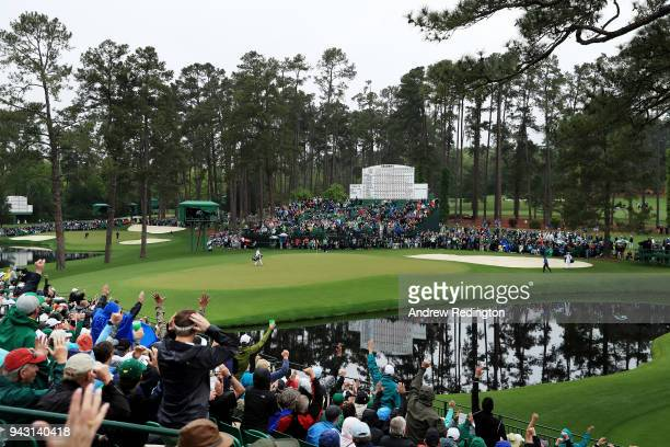 Patrick Reed of the United States chips in for eagle on the 15th green during the third round of the 2018 Masters Tournament at Augusta National Golf...