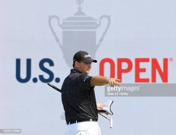 Patrick Reed of the United States gestures on the 17th green during a practice round prior to the start of the 2021 U.S. Open at Torrey Pines Golf...
