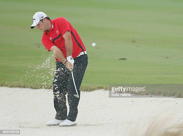 Patrick Reed of the United States hits a fairway bunker shot on the third hole during the final round of the Hero World Challenge at Albany The...