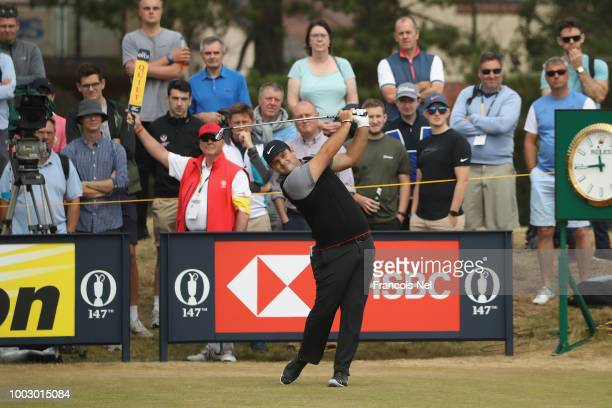 Patrick Reed of the United States hits a tee shot on the 12th hole during the third round of the 147th Open Championship at Carnoustie Golf Club on...