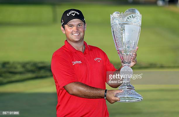 Patrick Reed of the United States holds the trophy after his win during the final round of The Barclays in the PGA Tour FedExCup PlayOffs on the...