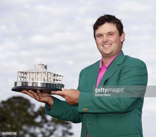 Patrick Reed of the United States holds the trophy after winning the Masters Tournament for his first major title in Augusta Georgia on April 8 2018...