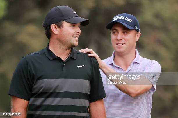 Patrick Reed of the United States is congratulated by Justin Thomas of the United States on the 18th green after winning during the final round of...
