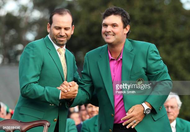 Patrick Reed of the United States is congratulated by Sergio Garcia of Spain after being presented the green jacket after winning the 2018 Masters...