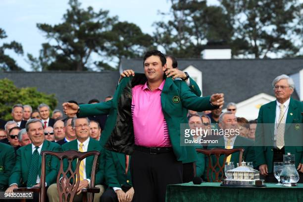 Patrick Reed of the United States is presented with the green jacket by Sergio Garcia of Spain after winning the 2018 Masters Tournament at Augusta...