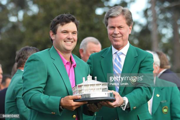 Patrick Reed of the United States is smiles with Fred Ridley Chairman of Augusta National Golf Club after being awarded the trophy during the green...