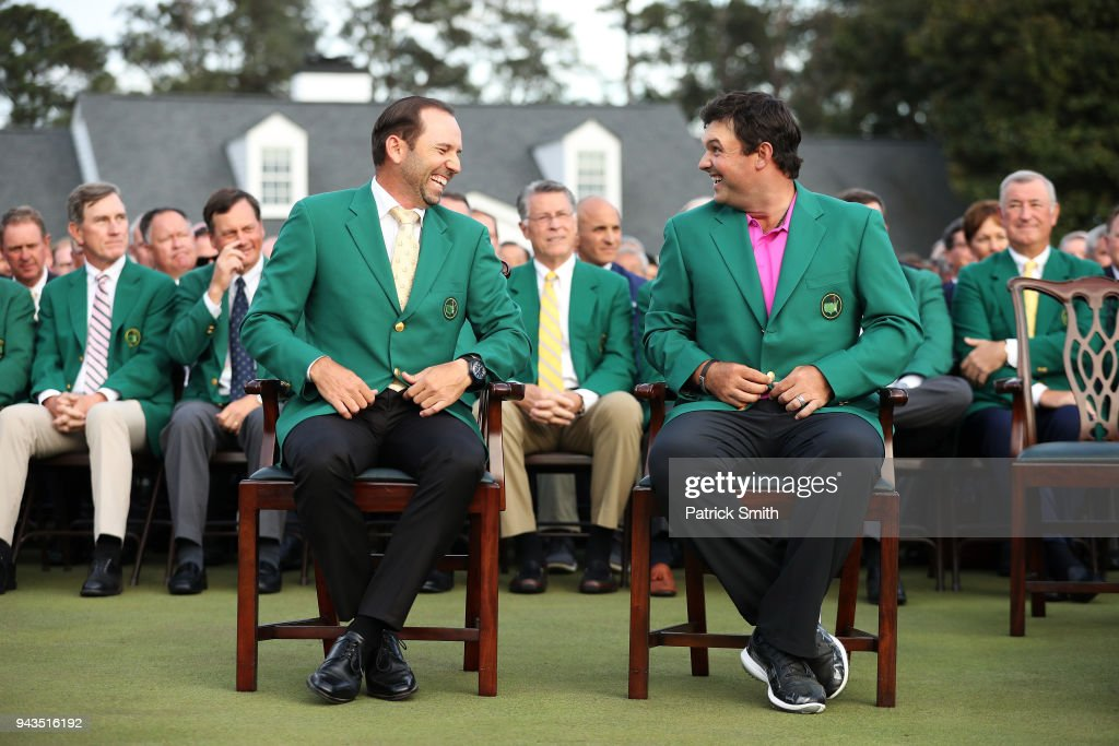 Patrick Reed (R) of the United States laughs with Sergio Garcia (L) of Spain after being presented with the green jacket in honor of winning the 2018 Masters Tournament at Augusta National Golf Club on April 8, 2018 in Augusta, Georgia.