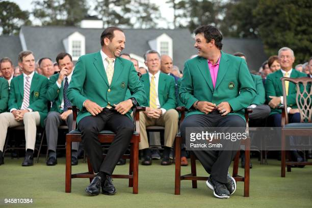 Patrick Reed of the United States laughs with Sergio Garcia of Spain after being presented with the green jacket in honor of winning the 2018 Masters...
