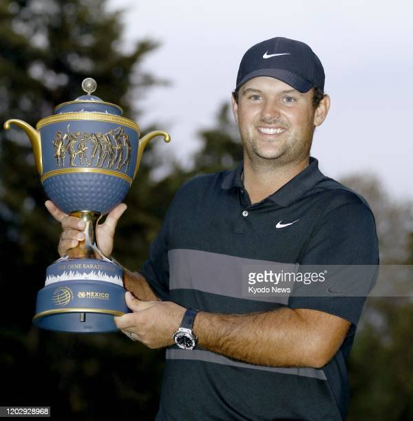 Patrick Reed of the United States lifts the trophy after winning the WGCMexico Championship at Club de Golf Chapultepec in Mexico City on Feb 23 2020