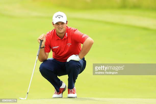 Patrick Reed of the United States lines up a putt on the 17th green during the third round of the 2017 US Open at Erin Hills on June 17 2017 in...