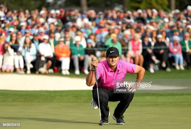 Patrick Reed of the United States lines up a putt on the 18th green during the final round of the 2018 Masters Tournament at Augusta National Golf...