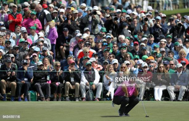 Patrick Reed of the United States lines up a putt on the second green during the final round of the 2018 Masters Tournament at Augusta National Golf...