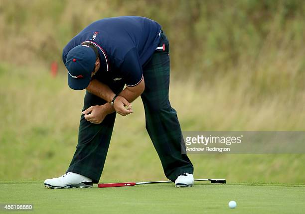 Patrick Reed of the United States misses a putt on the 15th green during the Afternoon Foursomes of the 2014 Ryder Cup on the PGA Centenary course at...