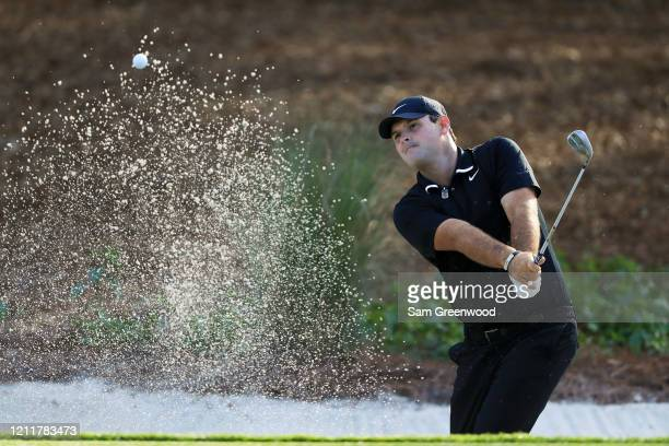 Patrick Reed of the United States plays a shot from a bunker during a practice round prior to The PLAYERS Championship on The Stadium Course at TPC...