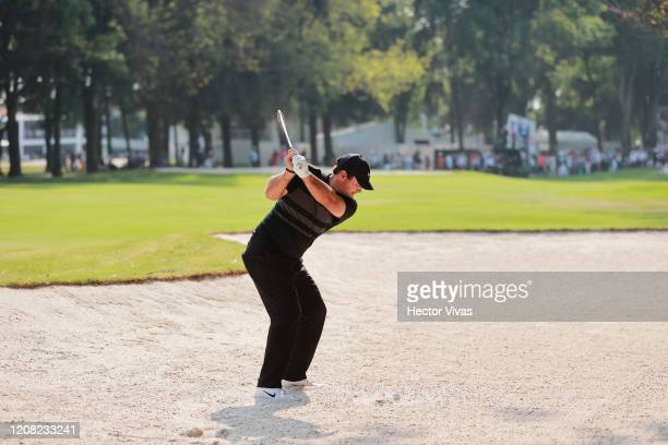 Patrick Reed of the United States plays a shot from a bunker on the ninth hole during the final round of the World Golf Championships Mexico...