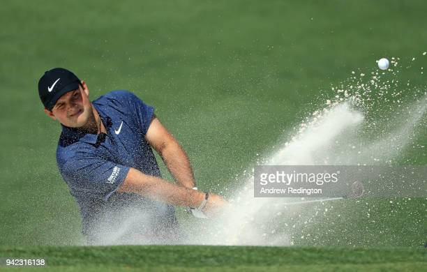 Patrick Reed of the United States plays a shot from a bunker on the second hole during the first round of the 2018 Masters Tournament at Augusta...