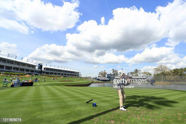 Patrick Reed of the United States plays a shot on the 17th hole during a practice round prior to The PLAYERS Championship on The Stadium Course at...
