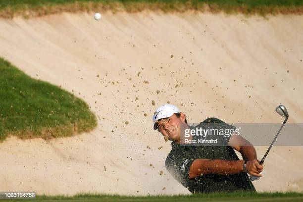 Patrick Reed of the United States plays a shot out of the bunker on the 18th hole during day four of the DP World Tour Championship at Jumeirah Golf...