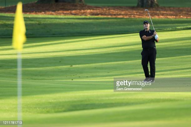 Patrick Reed of the United States plays an approach shot during a practice round prior to The PLAYERS Championship on The Stadium Course at TPC...