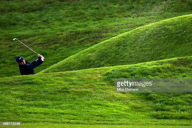 Patrick Reed of the United States plays from a bunker on the 2nd hole during the Morning Fourballs of the 2014 Ryder Cup on the PGA Centenary course...