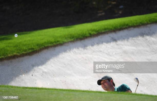 Patrick Reed of the United States plays his second shot from a bunker on the 4th hole during day one of the DP World Tour Championship at Jumeirah...