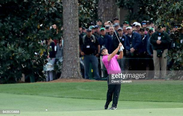 Patrick Reed of the United States plays his second shot on the 18th hole during the final round of the 2018 Masters Tournament at Augusta National...