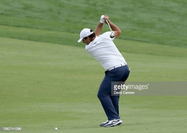 Patrick Reed of the United States plays his second shot on the par 5, 18th hole during the third round of the DP World Tour Championship on the Earth...