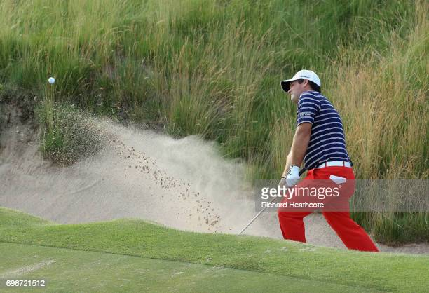 Patrick Reed of the United States plays his shot from a bunker on the 16th hole during the second round of the 2017 U.S. Open at Erin Hills on June...