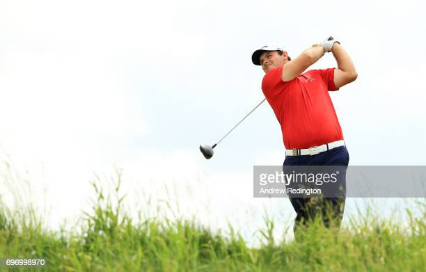 Patrick Reed of the United States plays his shot from the 18th tee during the third round of the 2017 US Open at Erin Hills on June 17 2017 in...