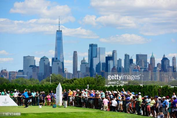 Patrick Reed of the United States plays his shot from the first tee during the final round of The Northern Trust at Liberty National Golf Club on...