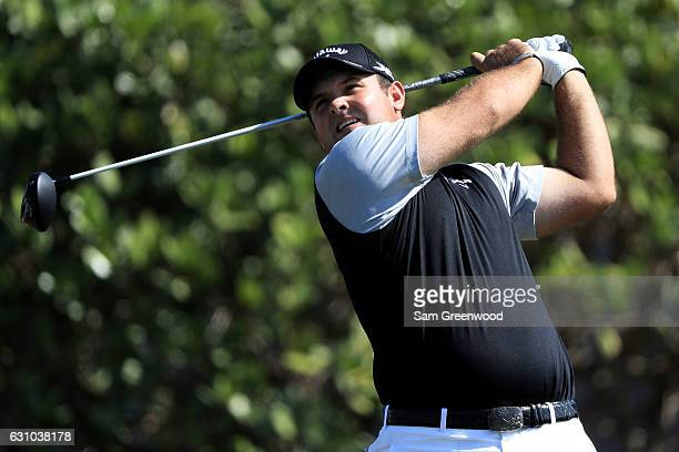 Patrick Reed of the United States plays his shot from the first tee during the first round of the SBS Tournament of Champions at the Plantation...