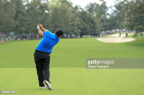 Patrick Reed of the United States plays his shot from the first tee during the third round of the 2018 Masters Tournament at Augusta National Golf...
