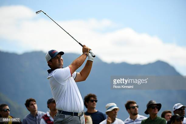 Patrick Reed of the United States plays his shot from the fourth tee during the first round of men's golf on Day 6 of the Rio 2016 Olympics at the...