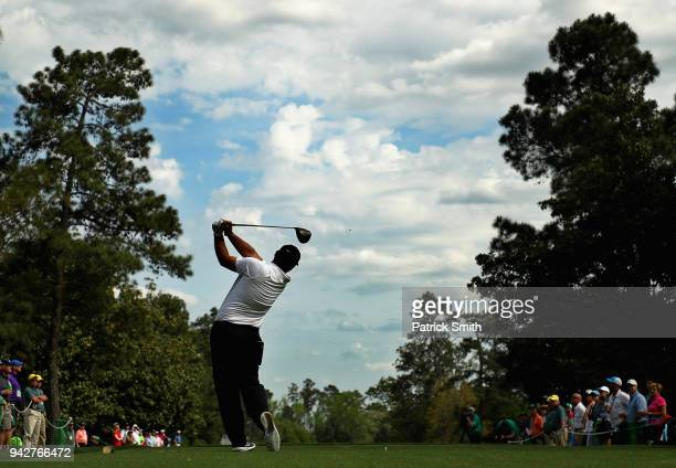 Patrick Reed of the United States plays his shot from the ninth tee during the second round of the 2018 Masters Tournament at Augusta National Golf...